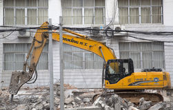 Machine demolition buildings Stock Images