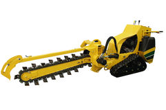Machine for digging trenches in the pavement Stock Photo