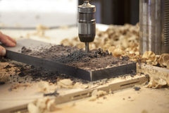 Machine drilling a hole Stock Image