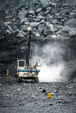 Machine drilling holes for demolition in Limestone Quarry Royalty Free Stock Photography