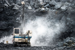Machine drilling holes in Limestone Quarry Royalty Free Stock Image