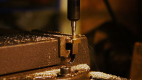 Machine drilling a metal. Close-up of machine drilling a metal stock video footage