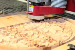 Machine is drilling wood Stock Image