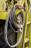 Machine Drive Belts. Some spare machine drive bels hanging on a harvester Royalty Free Stock Photography