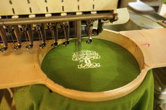 Machine embroidery sewing tree logo