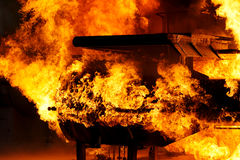 Machine on fire. Machine leaking gas and oil on fire Stock Photo