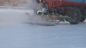 The machine pours ice on the rink stock video footage