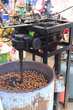 Machine for frying chestnuts Stock Photography