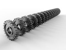 Machine gears arranged in a line Stock Images