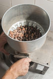 Machine for grinding cocoa. Stock Photos