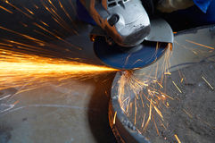Machine for grinding metal. In action and sparks spreading Stock Images