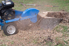 Machine Grinding Tree Stump Royalty Free Stock Images