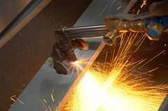 Machine for grinding/welding metal. And sparks spreading Royalty Free Stock Photos