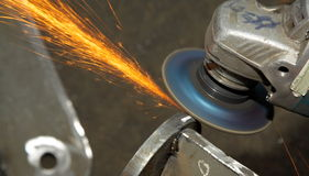Machine for grinding/welding metal. And sparks spreading Stock Images