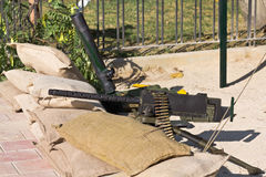 Machine Gun. Detail of Machine Gun behind sand bags, World War II style Royalty Free Stock Photo