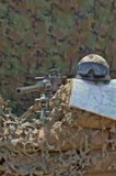 Machine gun. Helmet and map on a background of camouflage tent Royalty Free Stock Photography