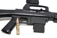 Machine gun. A black machine gun with ammunition Royalty Free Stock Image