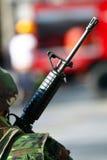 Machine gun. A photo of a soldier holding a machine gun Royalty Free Stock Photo