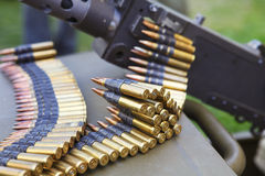 Machine gun with ammunition belt royalty free stock photos