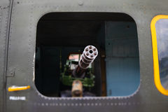 Machine gun in the army helicopter Stock Images