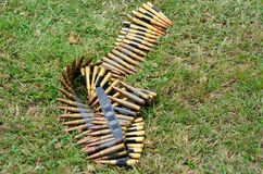 Machine gun bullets lying  on ground Royalty Free Stock Photos