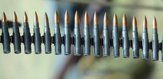 Machine gun bullets ready to be fired during the war exercise Stock Photos