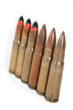 Machine gun bullets in a row Royalty Free Stock Images