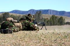Machine Gun Firing. A Royal Marine firing a light support weapon on a range in Australia royalty free stock photos