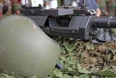 Machine gun and helmet Royalty Free Stock Image