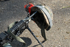 Machine gun and helmet Stock Photos