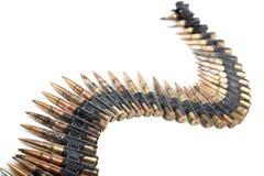 Machine-gun il nastro con le cartucce Fotografie Stock