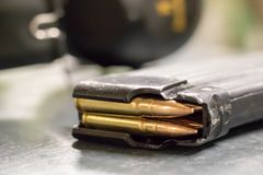 Machine gun magazine with bullets stock image