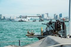 Machine gun on navy warship running on sea Royalty Free Stock Photo