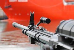 Machine Gun. A photo taken on a machine gun mounted on a battle ship Stock Image
