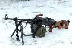 Machine gun PKM. 7.62-mm machine gun Kalashnikov PKM in the snow Stock Photos