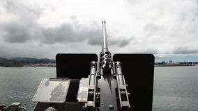 Machine gun sky. Old machine gun of the battleship against blue cloudy sky at Pearl Harbor memorial site. Honolulu Hawaii, Oahu island of United States stock video