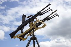 Machine gun on a stand against the sky Royalty Free Stock Photo