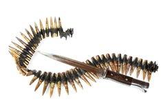 Machine-gun tape and bayonet-knife Stock Photography