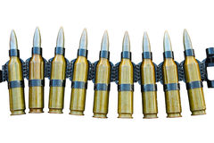 Machine gun tape with cartridges Stock Photos