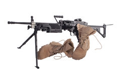 Machine gun and us army combat boots Royalty Free Stock Photos