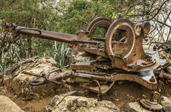 Machine Gun. Vintage machine gun in the woods of Mount Phou Si in Luang Prabang Royalty Free Stock Photos
