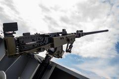 Machine gun on warship. Against dark sky Stock Photos