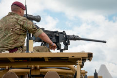 Machine gunner. Duxford, UK - 25th May 2014: British Army machine gunner at Duxford Airshow Stock Photo