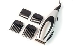 The machine for a hairstyle with attachments. Barbershop. Hair c. Lippers on white background stock photos