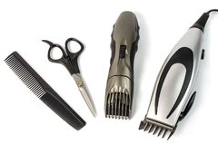The machine for a hairstyle and hair trimmer. Hair clippers and hair trimmer with comb and scissors isolated on white background. The machine for a hairstyle royalty free stock image