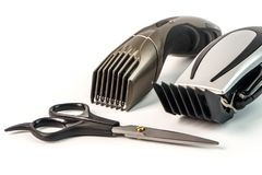 The machine for a hairstyle and hair trimmer. Hair clippers and. Hair trimmer with scissors on white background stock photography