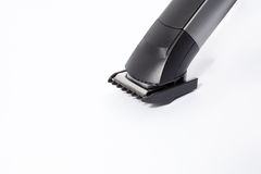 The machine for a hairstyle of hair. On white background royalty free stock image