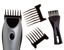 The machine for a hairstyle, nozzles and a brush. For edge cleaning royalty free stock photography