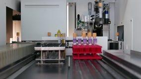 Machine laboratory analysis. Working machine laboratory blood analysis stock footage