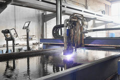 Machine for the laser cutting  metal in water Royalty Free Stock Photo
